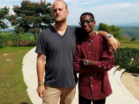Noah Wolf-Prusan with a village resident.