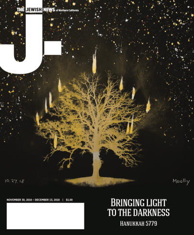 cover art for 11/30 issue of J.: a golden sillhouette of a tree on a black, paint-spattered background, with 11 candle-like flames coming off of its branches