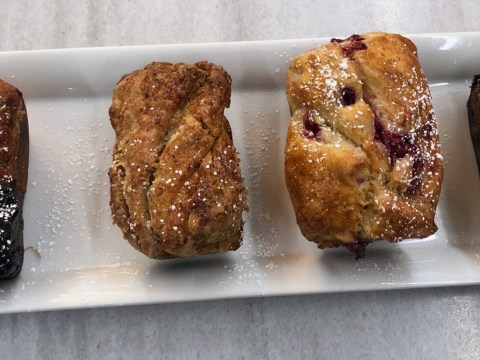 four babkas in a row, on a marble counter