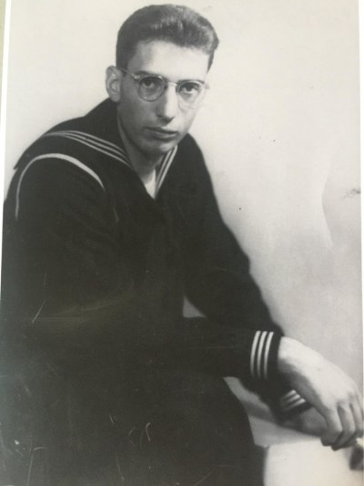 a man in glasses and a sailor uniform