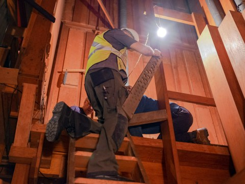 Workers temporarily remove the pipes from Congregation Sherith Israel's historic organ to allow seismic work to proceed. (Photo/Maurice Kamins)