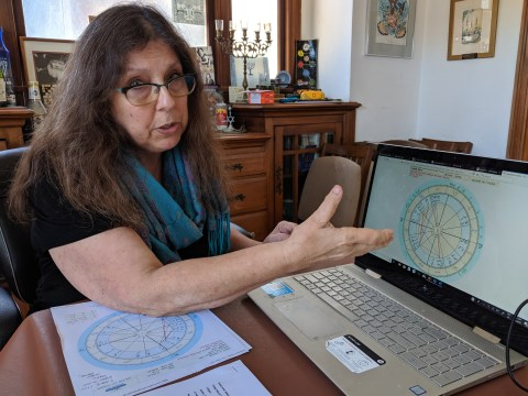 Lorelai Kude explains David A.M. Wilensky's natal chart in her Berkeley home, July 17, 2019 (Photo/David A.M. Wilensky)