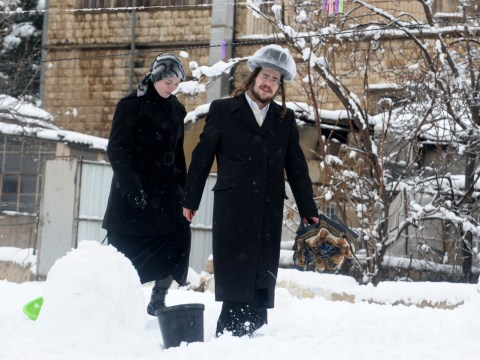 A haredi Jewish couple out walking after a 2013 snowstorm blanketed Jerusalem for several days.