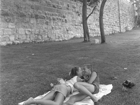 A young couple relaxing on the lawn outside the ancient walls of Jerusalem's Old City, 1983.
