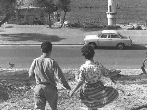 A couple walking hand in hand toward the Jaffa shore in 1963, from the top of what is today Old Jaffa's Gan HaPisga (Summit Garden).