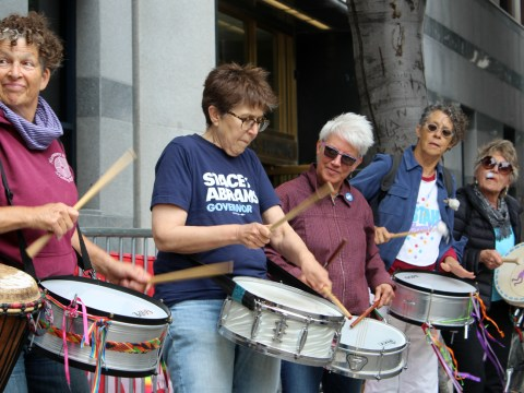Women drumming a protest at a San Francisco ICE protest on Aug. 1 (Photo/Tova Ricardo)