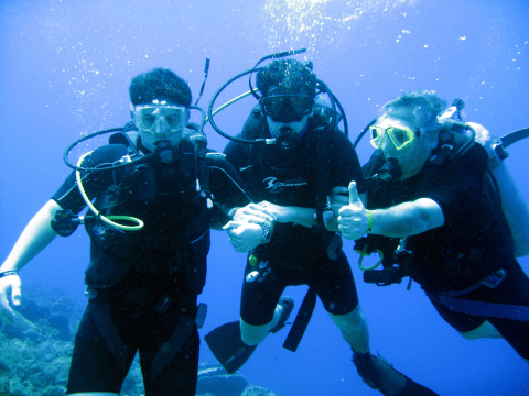 Nir Merry (right) diving with his sons Elan (left) and Oren. (Photo/Courtesy Nir Merry)
