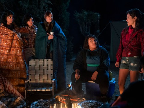 """Melrose (Jackie Tohn, far right) suggests holding a seder around the campfire in Season 3 of """"GLOW."""" (Photo/Courtesy Netflix-Ali Goldstein)"""