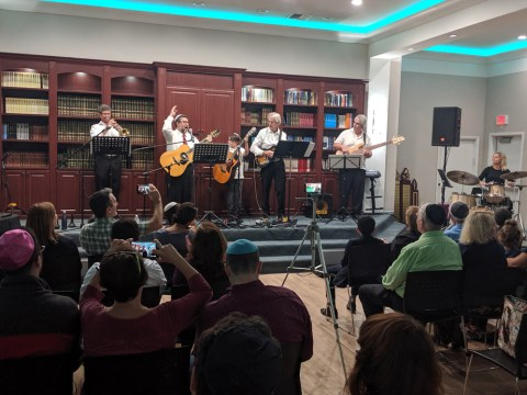 """Michael Regal (second from left) leads the concert at Chabad of the Tri-Valley's """"Unity Shabbat,"""" Sept. 20, 2019. (Photo/David A.M. Wilensky)"""