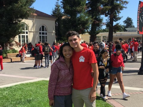 "Burlingame High School student body Vice President Heather Lee (left) and President Nicholas Gilmour embrace during the school's ""day of unity,"" held in response to a recent outbreak of hate-filled graffiti on the school's campus, Sept. 10, 2019. (Photo/Gabe Stutman)"
