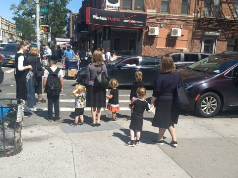 Women and children wait at a crosswalk in the Orthodox neighborhood of Borough Park, Brooklyn, Sept. 3, 2019. (Photo/JTA-Ben Sales)