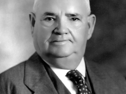 black and white portrait of a bald old man in a suit