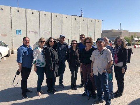The Bay Area rabbinic delegation at the Kerem Shalom crossing in Israel's south with Ami Shaked, supervisor of the site (at front in tan shirt and cap).