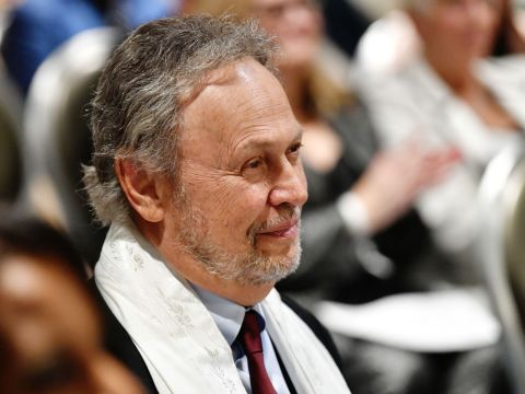 Billy Crystal watches the ceremony. (JTA/Netflix)