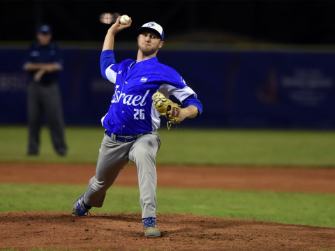 Gabe Cramer delivers a pitch during a Team Israel win over Italy in an Olympic qualifying game. (Margo Sugarman/Israel Association of Baseball)