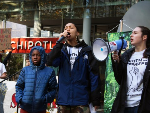 Isha Clarke (center), a high school senior from Oakland, emcees a Youth vs. Apocalypse protest in San Francisco, Dec. 6, 2019. (Photo/Gabriel Greschler)