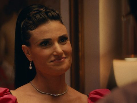 """Idina Menzel in her character's old bat mitzvah dress in """"Uncut Gems."""" (Courtesy A24)"""
