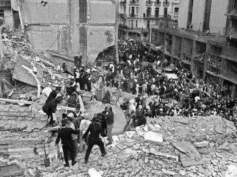 Firefighters and police officers search for victims of the AMIA center bombing in Buenos Aires, July 18, 1994. (JTA/Ali Bufari/AFP/Getty Images)