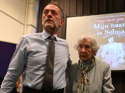 Selma van de Perre and her son, Jocelin, during a presentation of her book at the National Holocaust Museum, Jan. 9, 2020. (JTA/Cnaan Liphshiz)