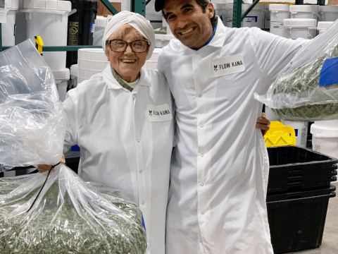 Michael Steinmetz and his grandmother Masha during her recent visit to the Flow Kana factory. (Courtesy Flow Kana)