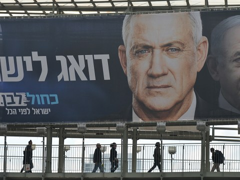 A campaign billboard in Ramat Gan, a suburb of Tel Aviv, featuring Blue and White party leader Benny Gantz in front of Israeli Prime Minister Benjamin Netanyahu. (Photo/JTA-Artur Widak-Getty Images)