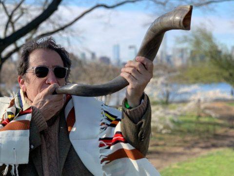 Hazon CEO Nigel Savage practices blowing his shofar. (Photo/Courtesy Hazon)