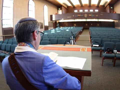 Rabbi Mark Bloom streams a live Shabbat service from Temple Beth Abraham in Oakland, May 2020. (Photo/Michael Fox)