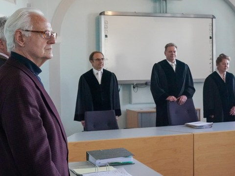 Michael Duellmann, foreground, stands in the courtroom of the Higher Regional Court in Naumburg for a hearing in his bid to remove the Judensau on the Wittenberg city church, Jan. 21, 2020. (Photo/JTA-Peter Endig-Picture Alliance via Getty Images)