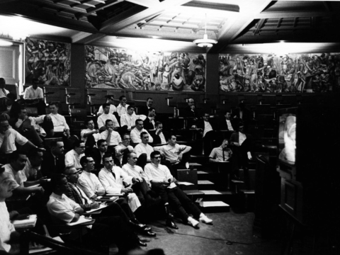 A 1962 lecture in UCSF's Toland Hall, the walls of which are dominated by Bernard Zakheim's expansive WPA mural. (Photo/UCSF Archives and Special Collections)