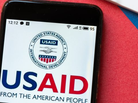 the USAID logo seen displayed on a smartphone
