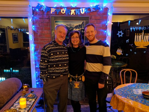 Mary and Bill Weinberg and their son Danny at last year's Hanukkah party.