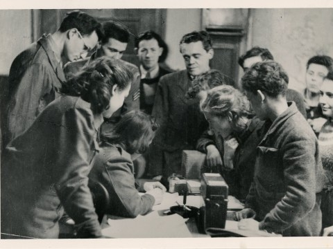 The author's father, James Rice (left, wearing glasses) in 1946 supervising registration of displaced persons at a DP camp near Linz, Austria. (Photo/Courtesy Michael Rice)