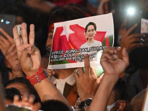 A protester holds an image of the detained Myanmar civilian leader Aung San Suu Kyi during a demonstration condemning the military coup outside the Myanmar Embassy in Bangkok, Thailand, Feb. 4, 2021. (Photo/JTA-Mladen Antonov-AFP via Getty Images)