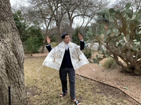 Austin resident Sam Robinson celebrates becoming a bar mitzvah in his backyard after a power outage at his synagogue from Winter Storm Uri scrapped his plans to read from three Torahs on the bimah.