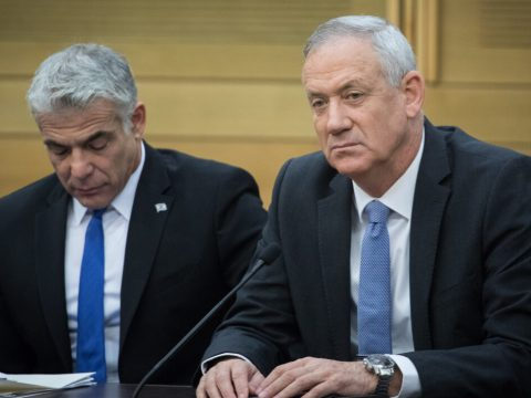 Yair Lapid (left) and Benny Gantz, then the chairmen of the Blue and White party, during a faction meeting at the Knesset in Jerusalem, Nov. 18, 2019. (Photo/JTA-Hadas Parush-Flash90)