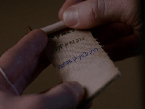 """In the long-running CW series """"Supernatural,"""" this scroll was found inside a golem. (Screenshot)"""