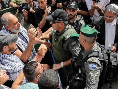 Israeli security forces clash with demonstrators during a protest against Israel's plan to evict Palestinians from the eastern Jerusalem neighborhood of Sheikh Jarrah on May 10, 2021. Itamar Ben-Gvir, a far-right Israeli lawmaker, is at right wearing a white kippah. (Photo/JTA-Olivier Fitoussi-Flash90)