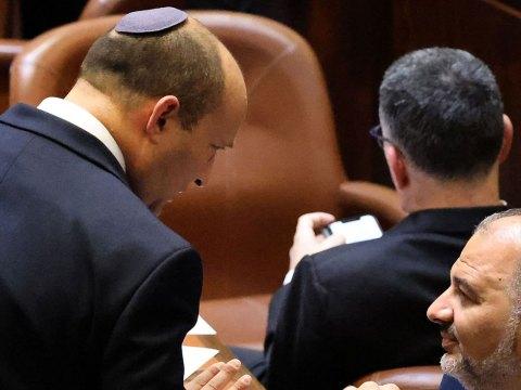 Naftali Bennett speaks in the Knesset with coalition partner Mansour Abbas on the day that Bennett became prime minister of Israel, June 13, 2021. (Photo/JTA-Emmanuel Dunand-AFP via Getty Images)