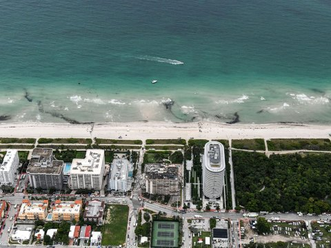 This aerial view shows search and rescue personnel working after the partial collapse of the Champlain Towers South in Surfside, north of Miami Beach, on June 24, 2021. (Photo/JTA-Chandan Khanna-AFP via Getty)