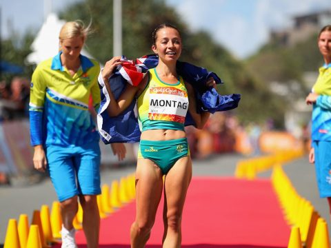 Jemima Montag celebrates her gold medal in the Women's 20km Race Walk Final at the Gold Coast Commonwealth Games in Australia, April 8, 2018. (Photo/JTA-Scott Barbour-Getty Images)