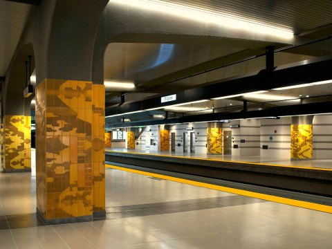 """Amy Tractenberg's """"Ecstatic Voyaging"""" is an installation of patterned ceramic tiles on the columns of the Milpitas BART station."""