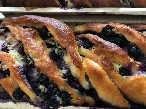 closeup of a babka with blueberries visible on top