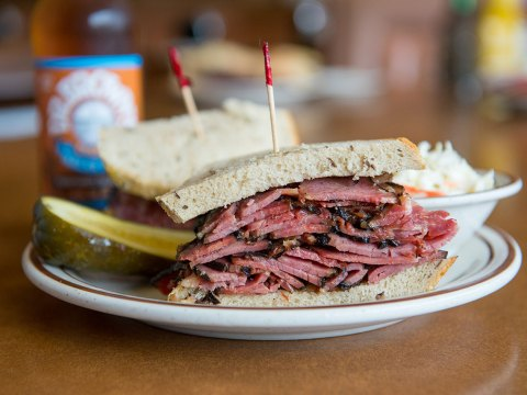 Canter's pastrami on grilled rye, with sauerkraut and a pickle.