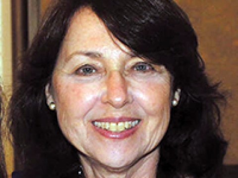 headshot of a smiling white woman with dark hair