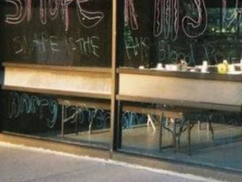 The spoiler was painted on the glass wall of the camp's dining hall.