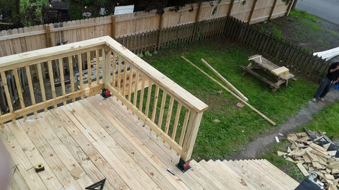 Railing construction and installation started on the rooftop deck in this Manchester MD 21088 remodel
