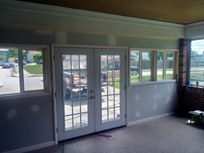 Custom trim installed around door and windows in Hanover PA garage addition