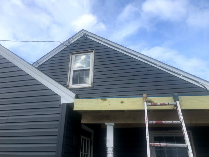 Siding repair in Hanover PA 17331 by JWE Remodeling and Roofing including custom trm and fascia