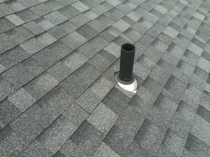 Vent pipe boot installation during New Oxford PA roof replacement by JWE
