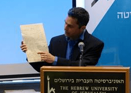 Prof. Barak Kol, chairman of the Hebrew University's Racah Institute of Physics, holds a page from Einstein's General Theory of Relativity.  Photo: Dov Smith for The Hebrew University of Jerusalem